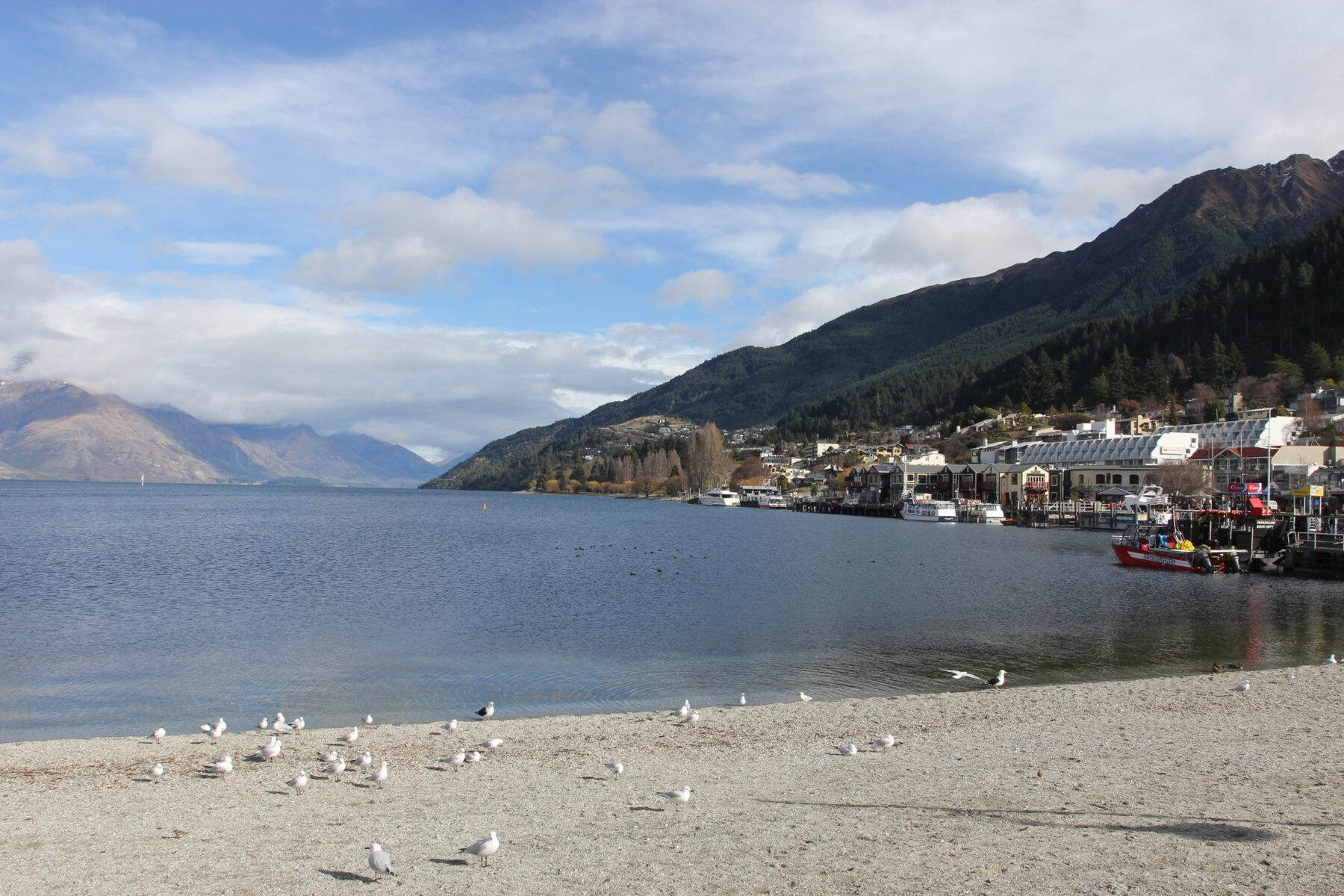 Edge of the lake in Queenstown, New Zealand. Find out if LivingSocial Escapes and Groupon Getaways are good deals or a scam in our Living Social & Groupon travel reviews.