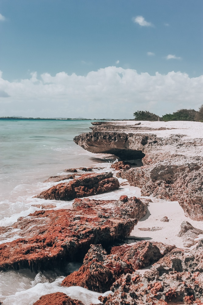 Rock formations on the beaches of Bonaire. With so many great beaches and water activities, find the best things to do in Bonaire and the best beaches in Bonaire here.