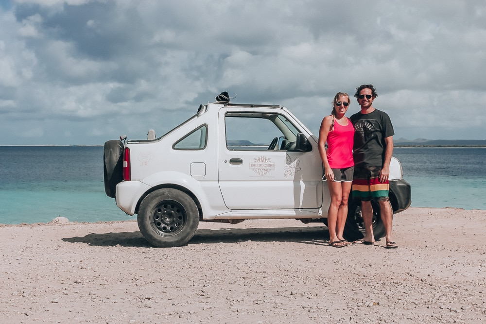 Our rental car in Bonaire on the beach. Renting a car in Bonaire was the best thing we did in Bonaire since it let us see the whole island. Find all the best things to do in Bonaire on a cruise here.
