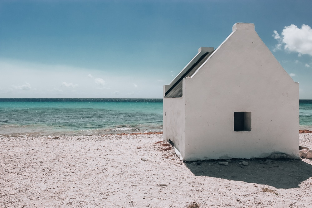 Former slave hut on the beach of Bonaire where the slaves lived to work the salt ponds. Find all the best things to do and see in Bonaire here.