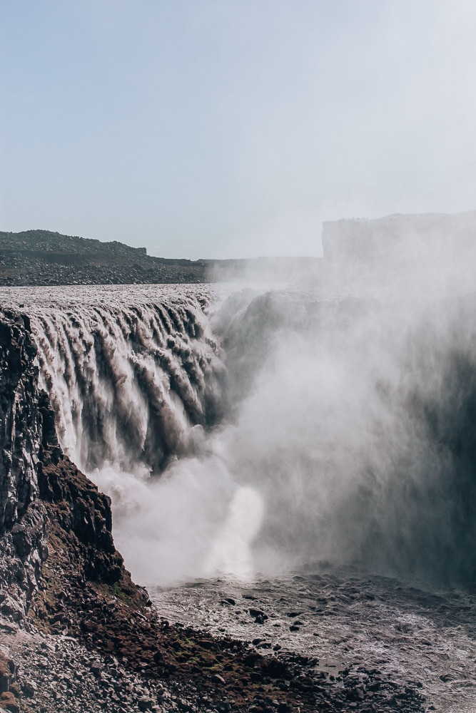 Dettifoss Waterfall in Iceland from the east side of the canyon. Find the top 5 waterfalls in Iceland that you don't want to miss on a Ring Road road trip.