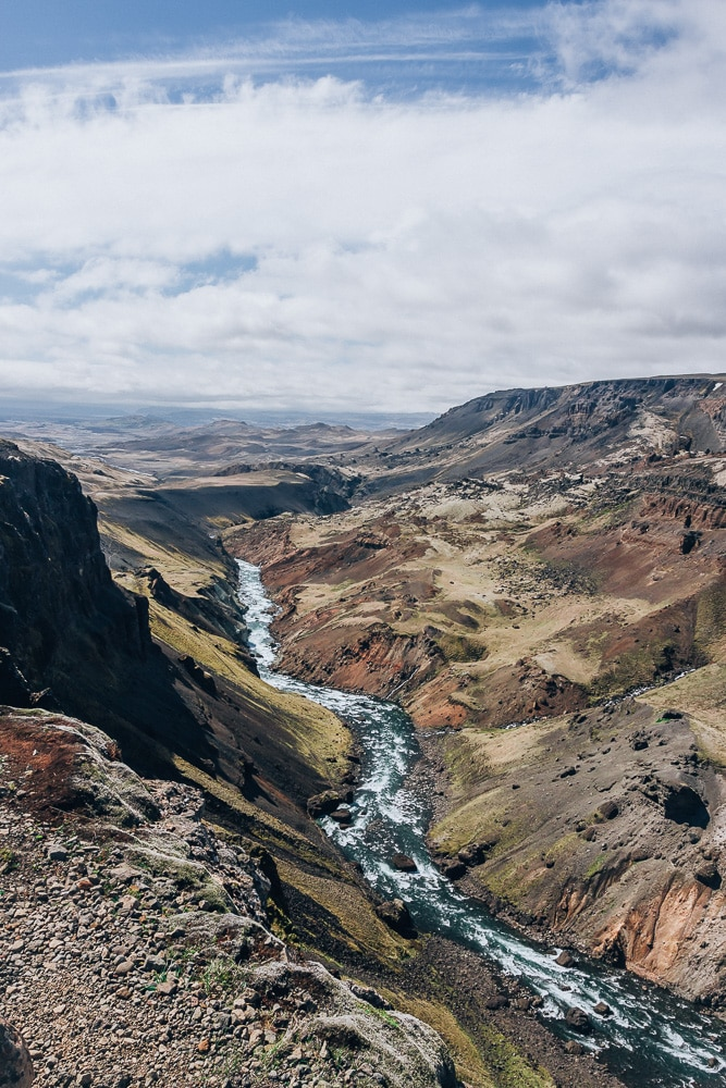 Looking down the gorge next to Haifoss waterfall in Iceland. Find the top 5 waterfalls in Iceland that you don't want to miss on a Ring Road road trip.
