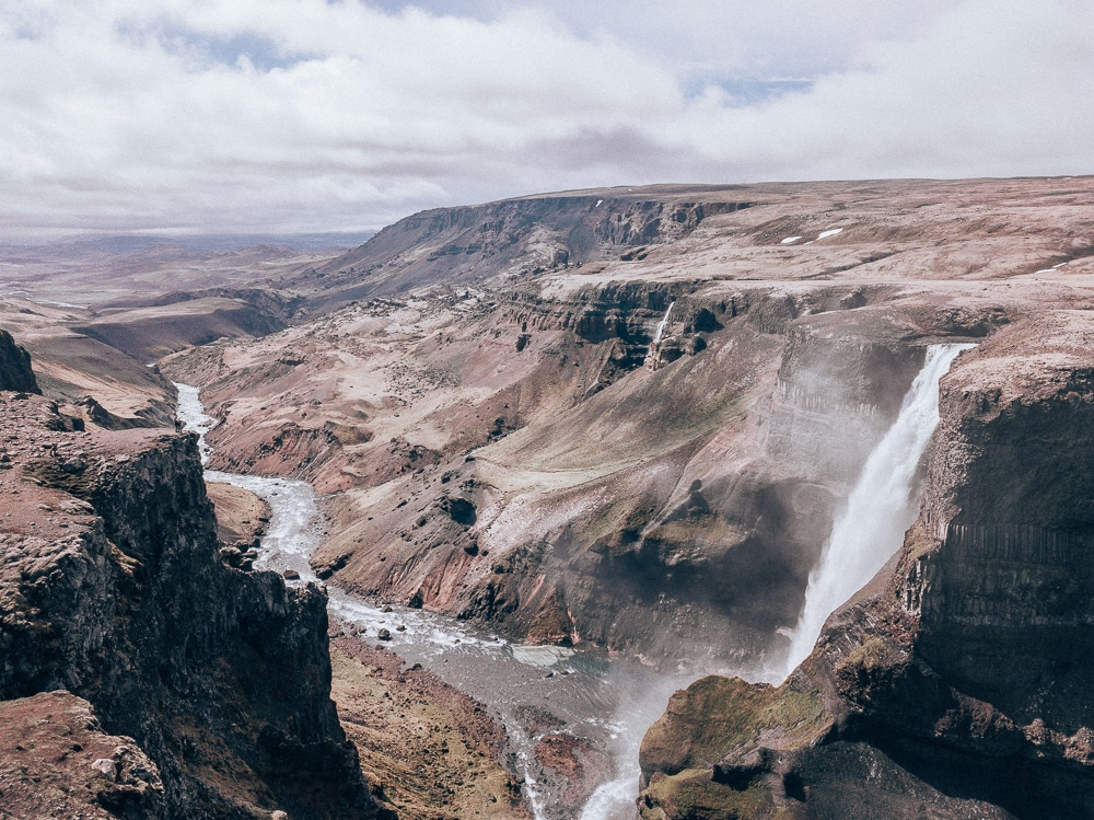Haifoss waterfall in Iceland and the canyon beyond it. Find the top 5 waterfalls in Iceland that you don't want to miss on a Ring Road road trip.