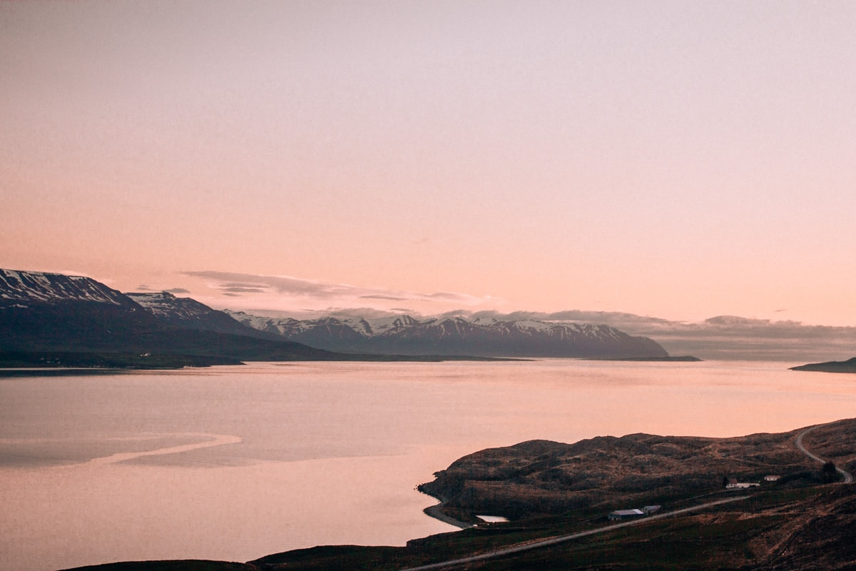 Akureyri Iceland at sunset during the summer. Check out our perfect 6 day itinerary for Ring Road in Iceland!