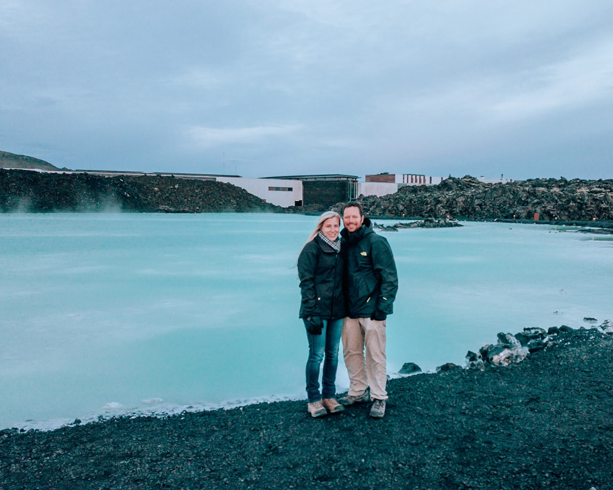 Couple at free part of Blue Lagoon in Iceland near Reykjavik. Get a fun guide to Iceland for couples on an epic summer road trip around Ring Road here.