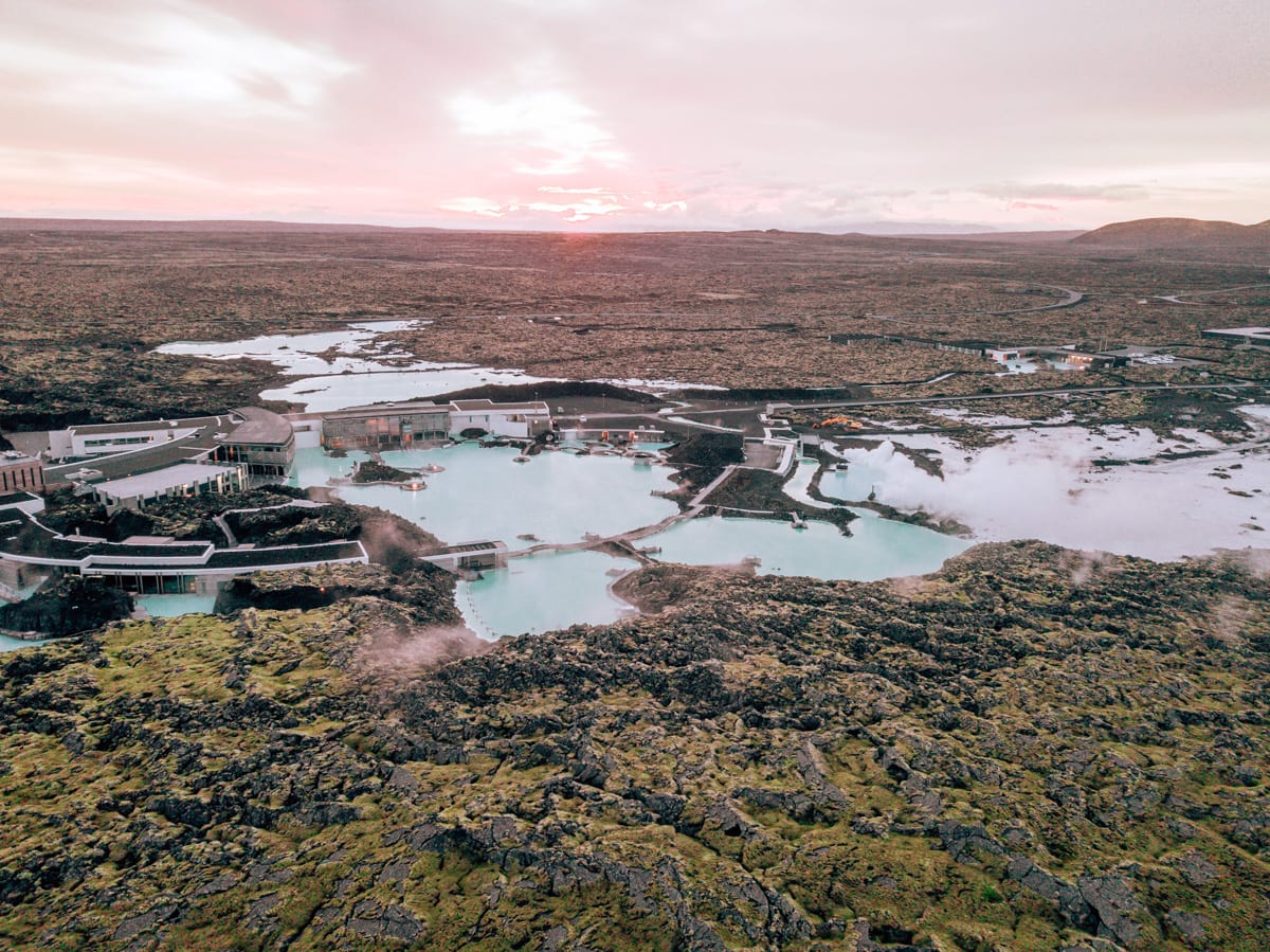 Summer sunrise over the Blue Lagoon in Iceland. Check out this 6 day itinerary for Iceland's Ring Road in summer.