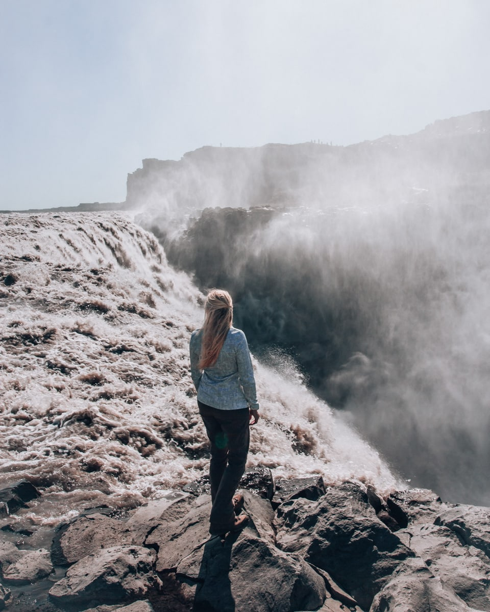 At Dettifoss in north eastern Iceland, you can stand right on the edge of the waterfall at the viewpoint on the east side. Get other useful Iceland travel tips with our full Iceland road trip itinerary.