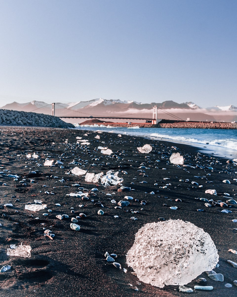 Pieces of ice shine in the sun on Diamond Beach in Iceland in the summer. Get all the best Iceland travel tips in our full Iceland travel guide with our 6 day Iceland itinerary.