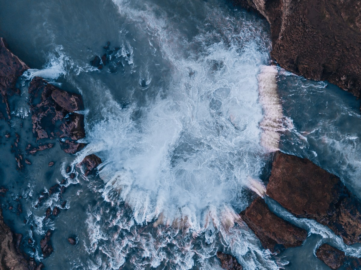 Drone view of Godafoss in Iceland in summer from above. Click here for the ultimate Ring Road road trip itinerary for Iceland in summer.