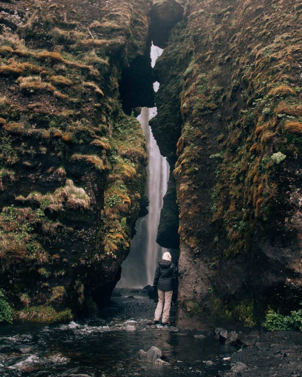 Looking into the depth of the canyon that houses Gljufrabui waterfall in southern Iceland. Get our full itinerary for a week in Iceland here!