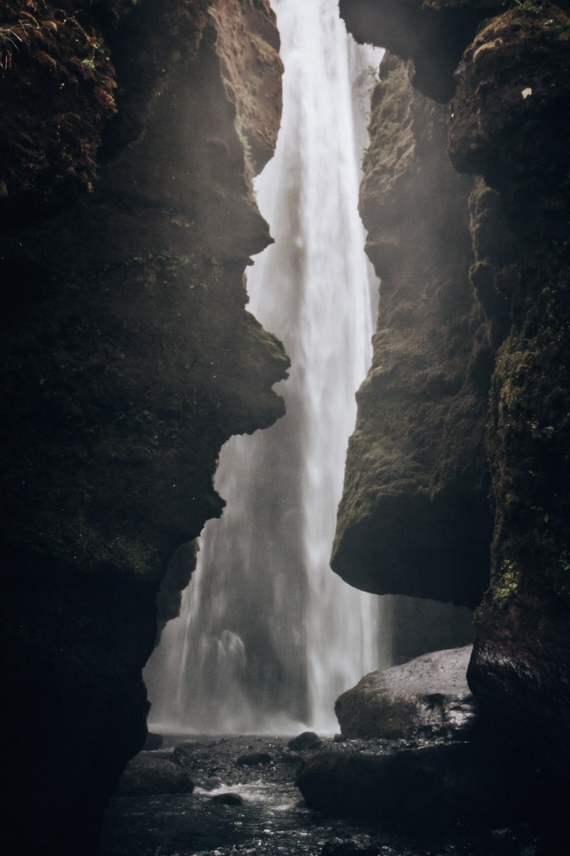Looking into the canyon of Gljufrabui waterfall in Iceland in summer. Click here for the ultimate 6 day Iceland itinerary with a free map to all the best stops.