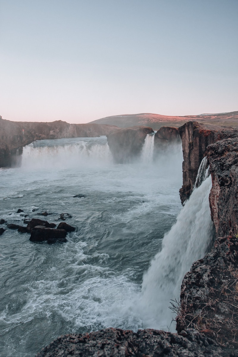 Side view of Godafoss waterfall in Iceland in summer. Get the perfect guide to summer in Iceland here with a full itinerary for Ring Road.