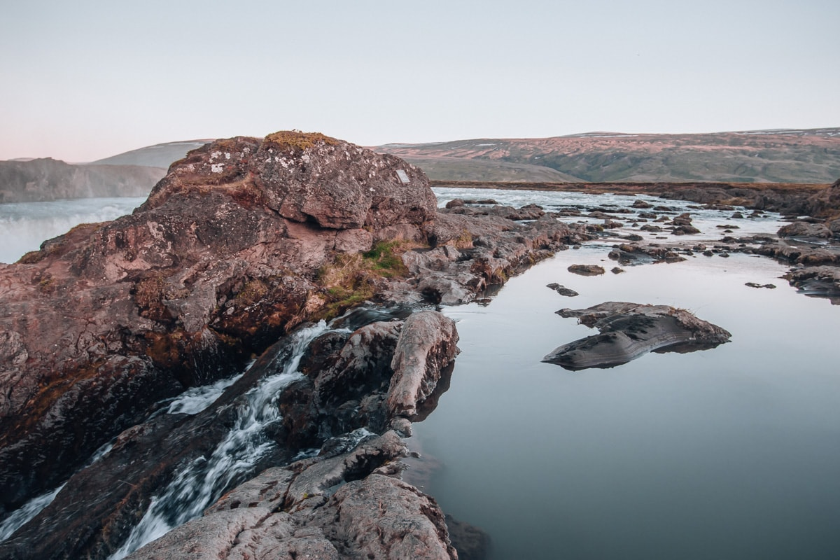Calm water at the top of Godafoss in Iceland. Check out our perfect 6 day itinerary for Ring Road in Iceland!