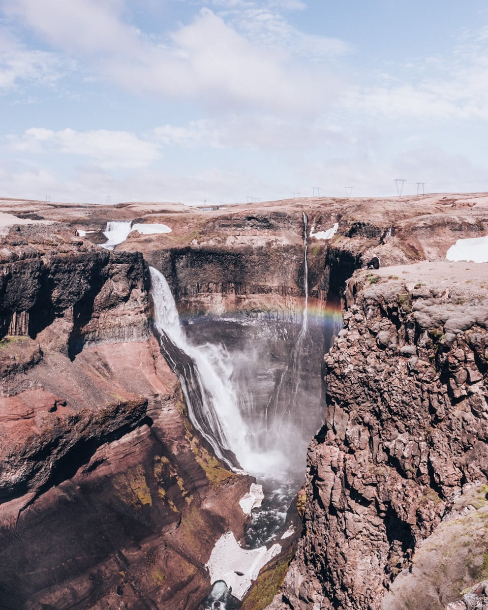 Rainbow through the mist at Haifoss in Iceland. Click here for a 6 day Iceland itinerary including Iceland's best waterfalls with a free map.