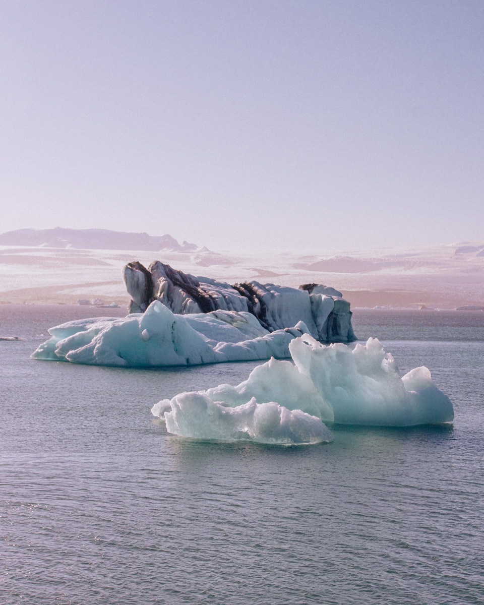 Pieces of glacier floating in Jokulsarlon Glacier Lagoon in Iceland in summer. Get all the best Iceland travel tips in our 6 day Iceland itinerary for the ultimate Iceland road trip here.