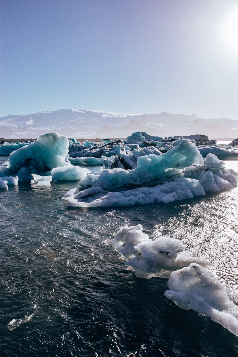 Pieces of ice floating in Jokulsarlon Glacier Lagoon in Iceland in summer. Find an Iceland itinerary for a week in Iceland here.