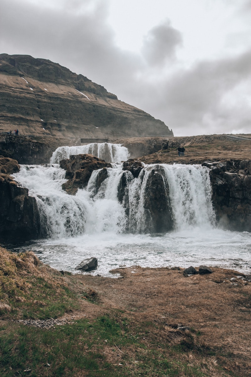 Kirkjufellsfoss in Iceland in summer. Find all the best Iceland road trip stops with these Iceland travel tips and itinerary.