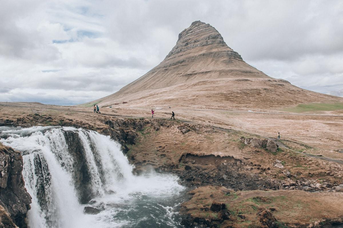Kirkjufell Mountain and Kirkjufellsfoss in Iceland in summer.