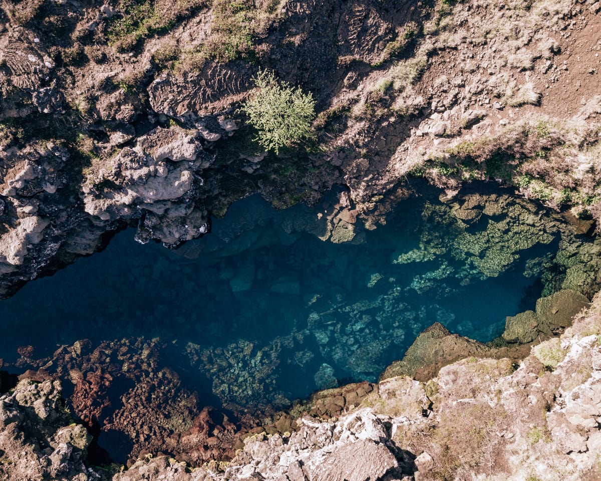Looking down on the crystal clear water in the Silfra dive site through the continental divide in Thingvellir National Park in Iceland. Check out our perfect 6 day itinerary for Ring Road in Iceland!