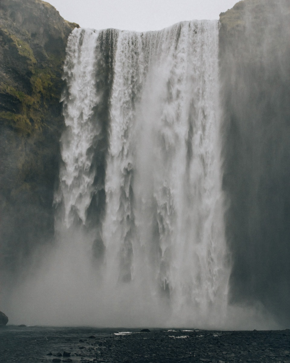 Water pours over Skogafoss Waterfall in southern Iceland. Get our full 6 day Iceland itinerary with a free map here!