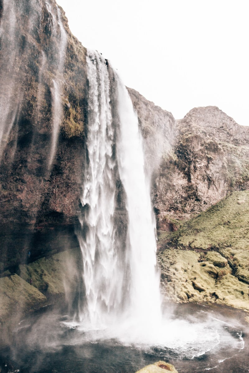 Seljalandsfoss Waterfall from the path that goes behind the waterfall. Check out this full itinerary for an Iceland road trip around Ring Road.