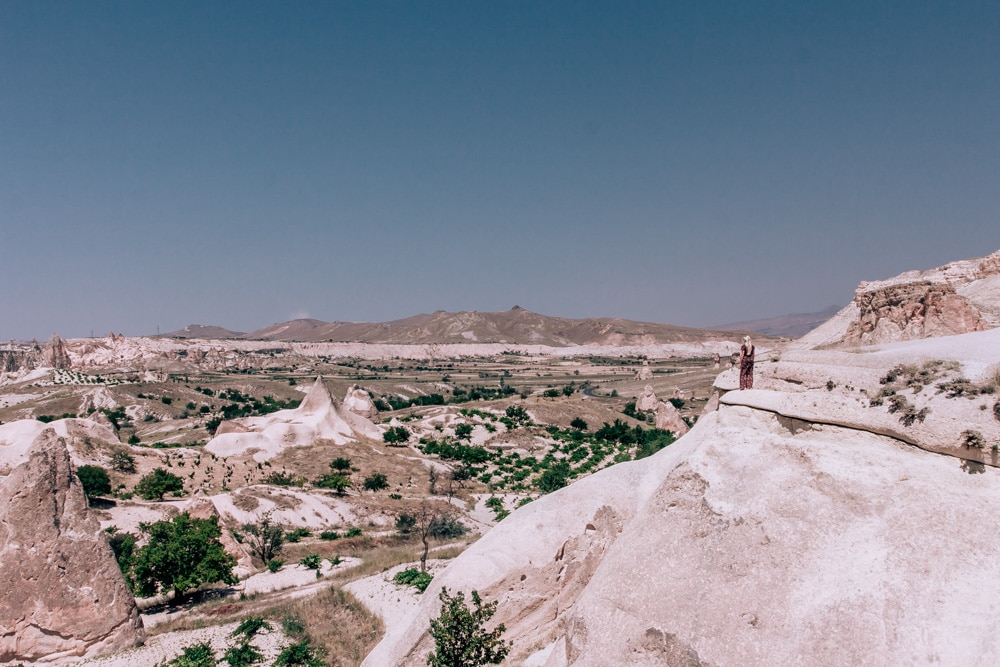 Looking out over the stunning landscape of Cappadocia from Pasabagi (Fairy Chimney Valley). Check out our full 3 day itinerary for all the best places to go for pictures!