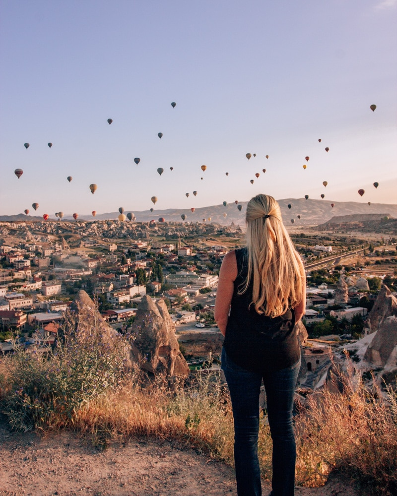 View from Sunset Point in Goreme at sunrise. Click for a 3 day itinerary and guide to Cappadocia's must see locations and most Instagramable places.