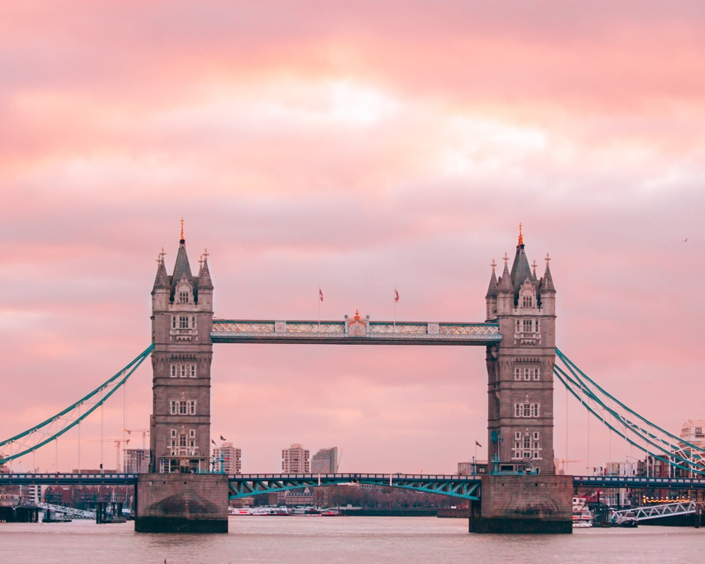 Tower Bridge in London is the perfect place to watch the sunrise before eating in the Coppa Club igloos.