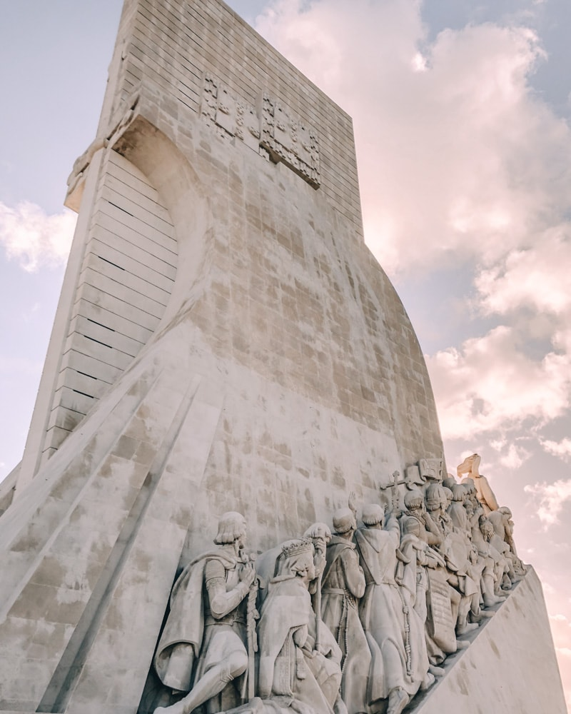 Monument to the Discoveries in Lisbon, Portugal. Find the best places in Lisbon for Instagrammable photos and when to go to get them to yourself!