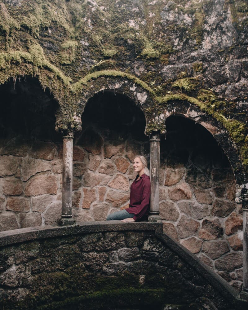 A woman in the initiation well at Quinta de Regaleira in Sintra, Portugal