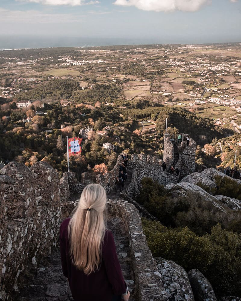 A woman looks out over Sintra from the Moorish Castle in Portugal