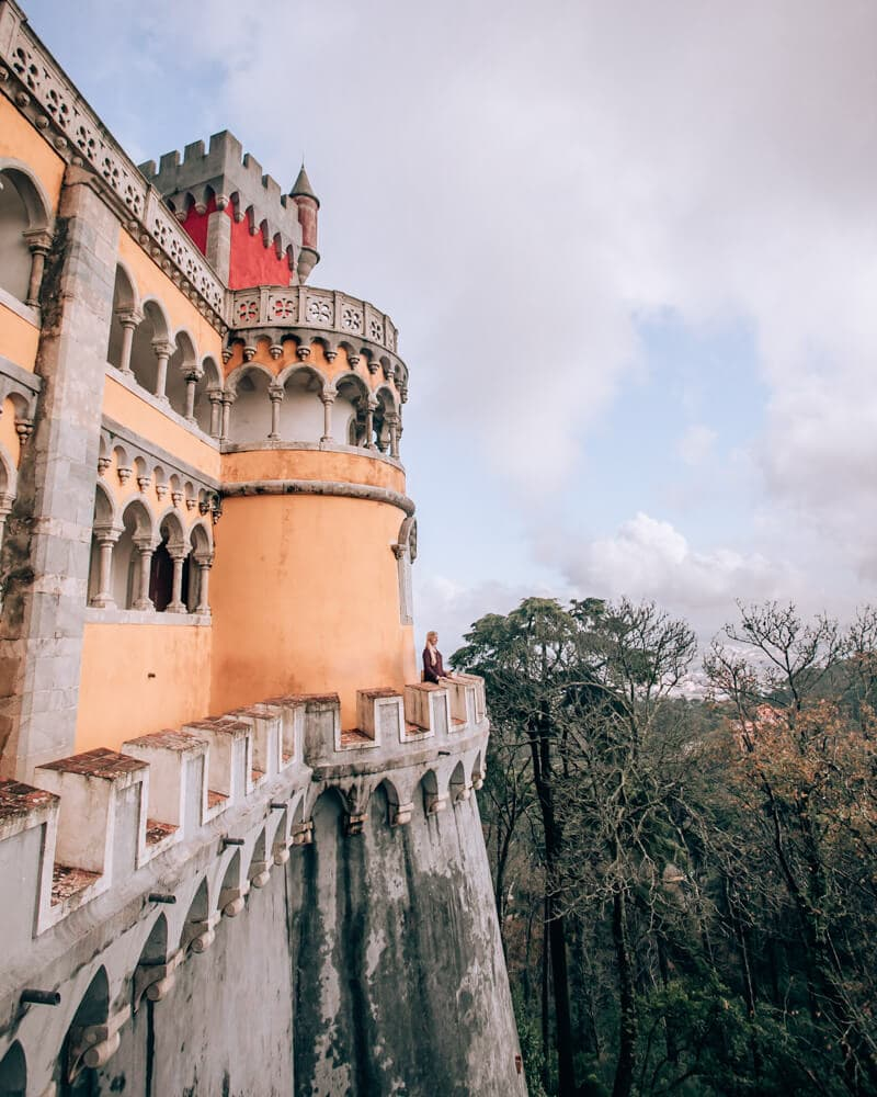 Woman at Pena Palace in Sintra, Portugal as part of a Sintra one day itinerary