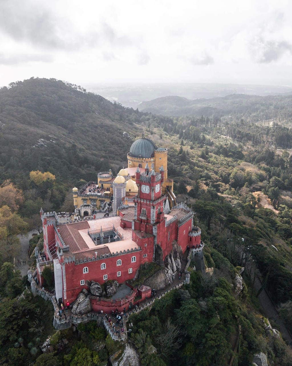 Drone shot with view from above Pena Palace in Sintra, Portugal on a Lisbon to Sintra day trip