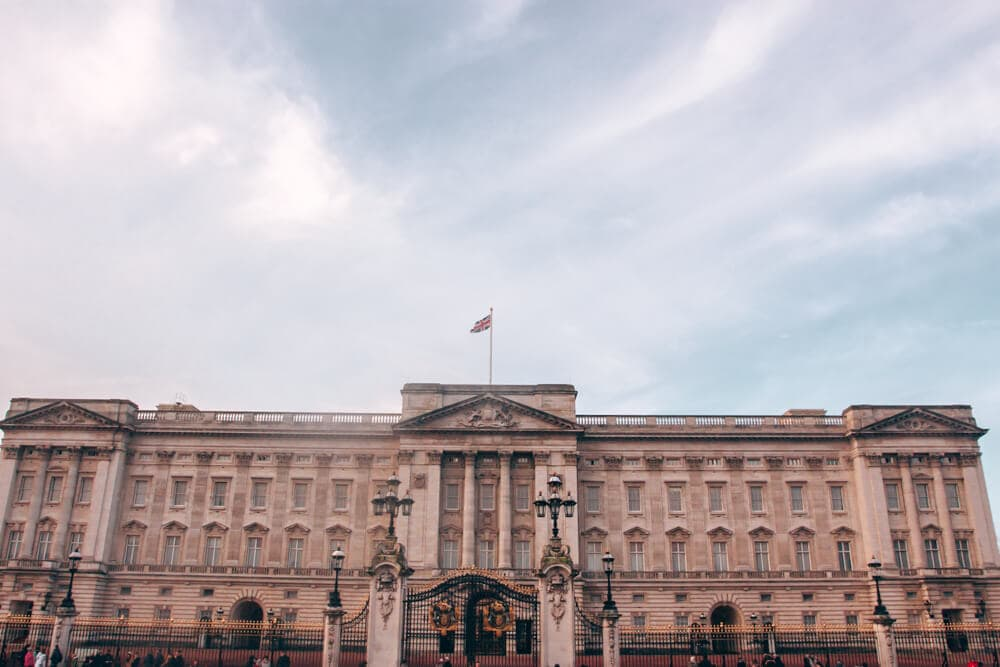 The beautiful Buckingham Palace and famous balcony early on a winter morning. Find the perfect 3 day itinerary for London with Instagrammable places to see, places to eat, and places to stay.