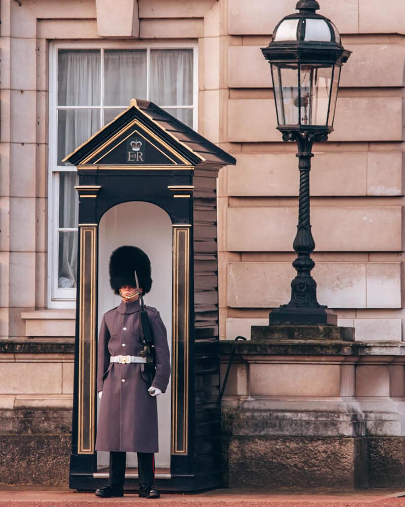 Guards are outside of Buckingham Palace 24 hours a day. Find out all the best things to do in London in 3 days here (+ a free map!).