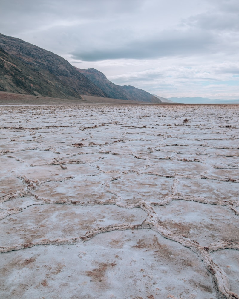 Along the walk to the salt flats in Badwater Basin, you will see dirt mixed with the sand until about half a mile out. Find a full one day itinerary for Death Valley including where to stay, what to see and do, and when to visit.