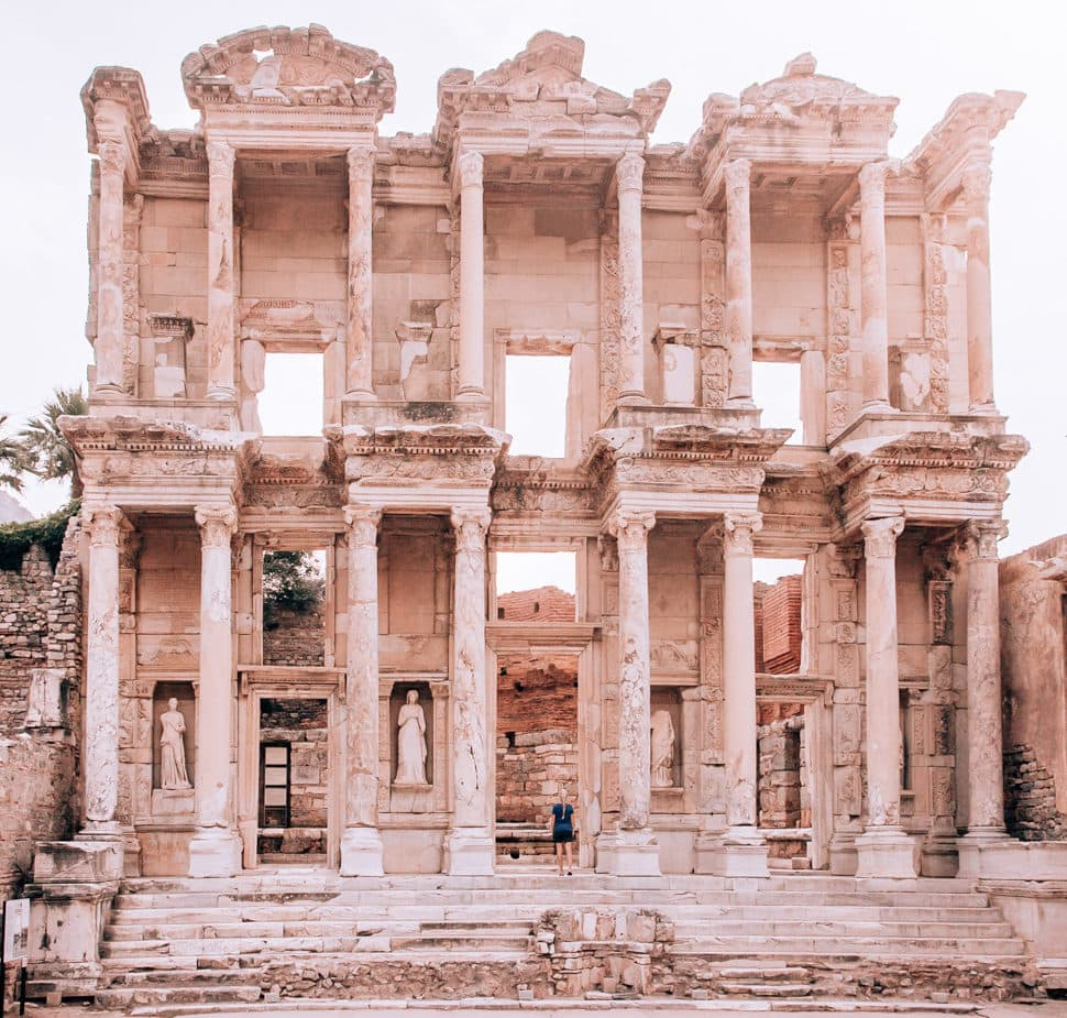The Library of Celsus in ancient Ephesus. Find a full one day itinerary with everything you need to know about visiting the ancient ruins of Ephesus in Turkey here.