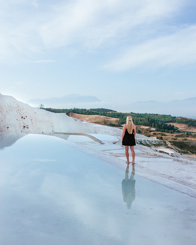 Enjoying the peace and quiet before the crowds arrive in Pamukkale. The Ultimate Guide to Visiting Pamukkale gives you all the information you need about what you can really expect, when to go, where to stay, and more.