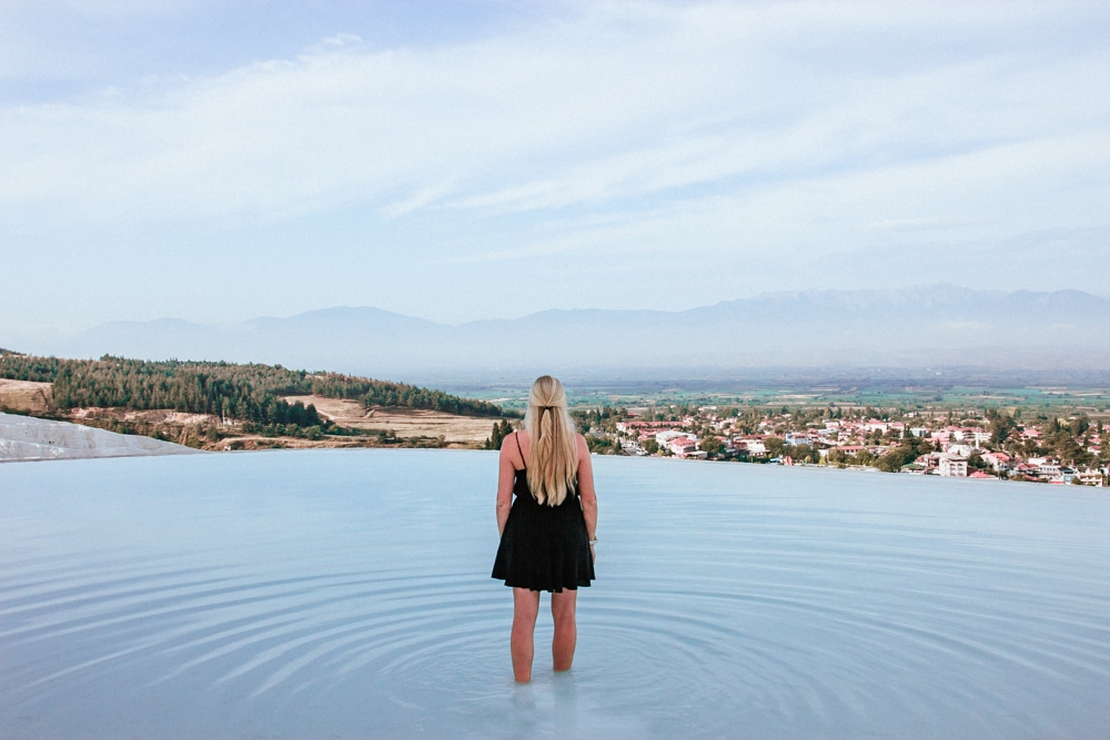 About halfway down the thermal pools at Pamukkale. The Ultimate Guide to Visiting Pamukkale gives you all the information you need about what you can really expect, when to go, where to stay, and more.