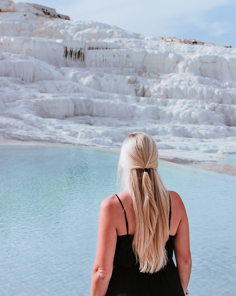 The lower pools at Pamukkale stay less crowded as most tours stay near the top. The Ultimate Guide to Visiting Pamukkale gives you all the information you need about what you can really expect, when to go, where to stay, and more.
