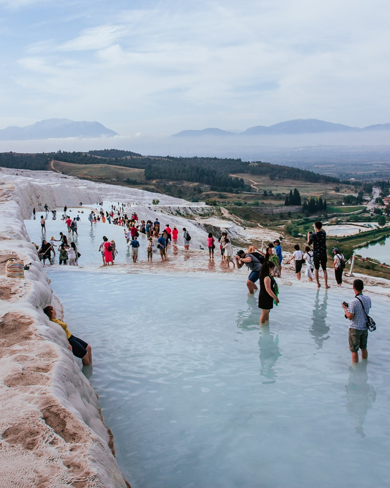 This is what Pamukkale really looks like most of the day, but the crowds mostly stay at the top. The Ultimate Guide to Visiting Pamukkale gives you all the information you need about what you can really expect, when to go, where to stay, and more.
