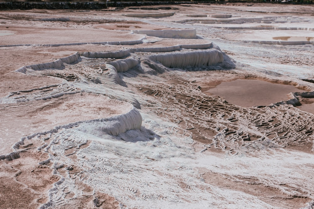 Many of Pamukkale's natural pools were damaged and are being restored. The Ultimate Guide to Visiting Pamukkale gives you all the information you need about what you can really expect, when to go, where to stay, and more.