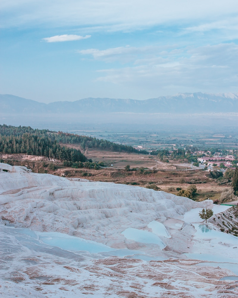 The natural and man-made pools that make up Pamukkale. The Ultimate Guide to Visiting Pamukkale gives you all the information you need about what you can really expect, when to go, where to stay, and more.
