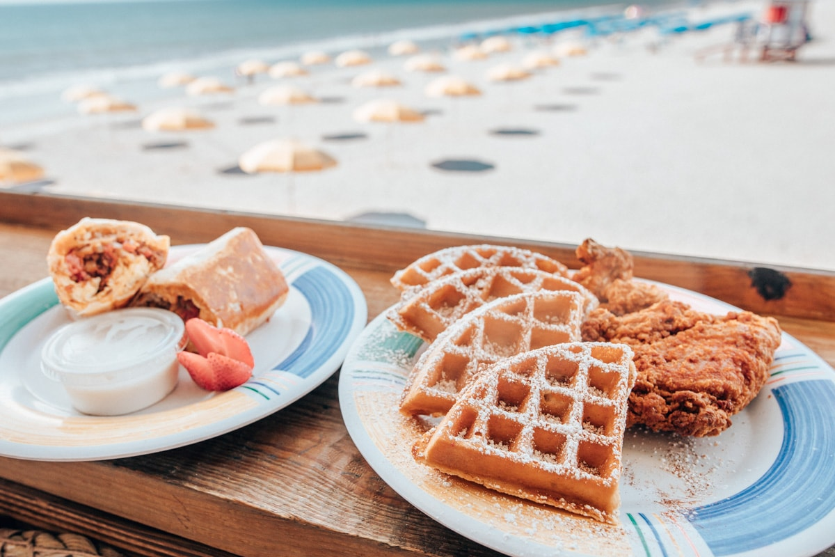 Breakfast burrito and chicken and waffles with a beach view at Boardwalk Bar on the Westgate Cocoa Beach Pier
