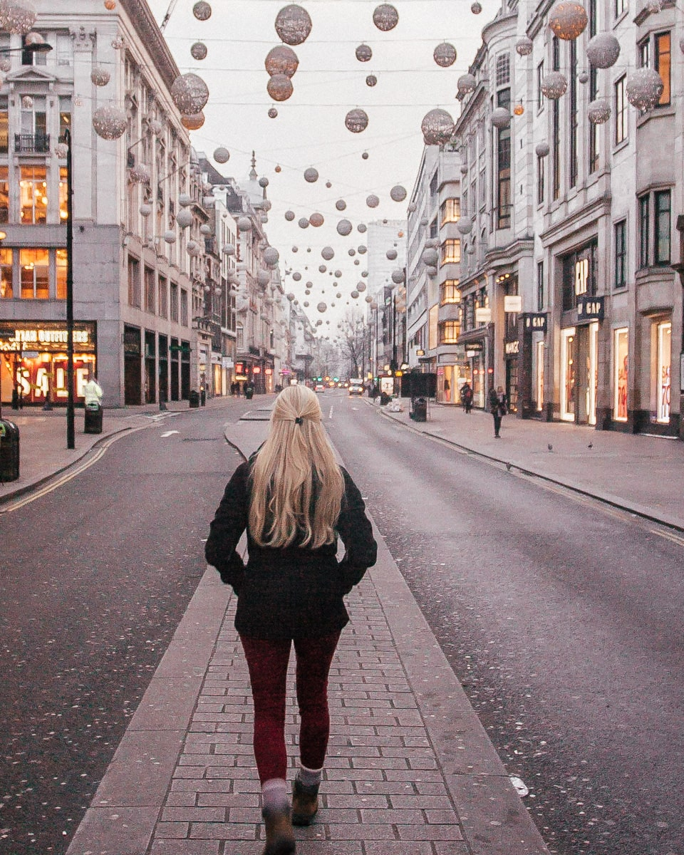 Walking down the median in Oxford Street near sunrise with the Christmas lights still on. Check out this full guide to Christmas lights in London including a free map to plan your trip.