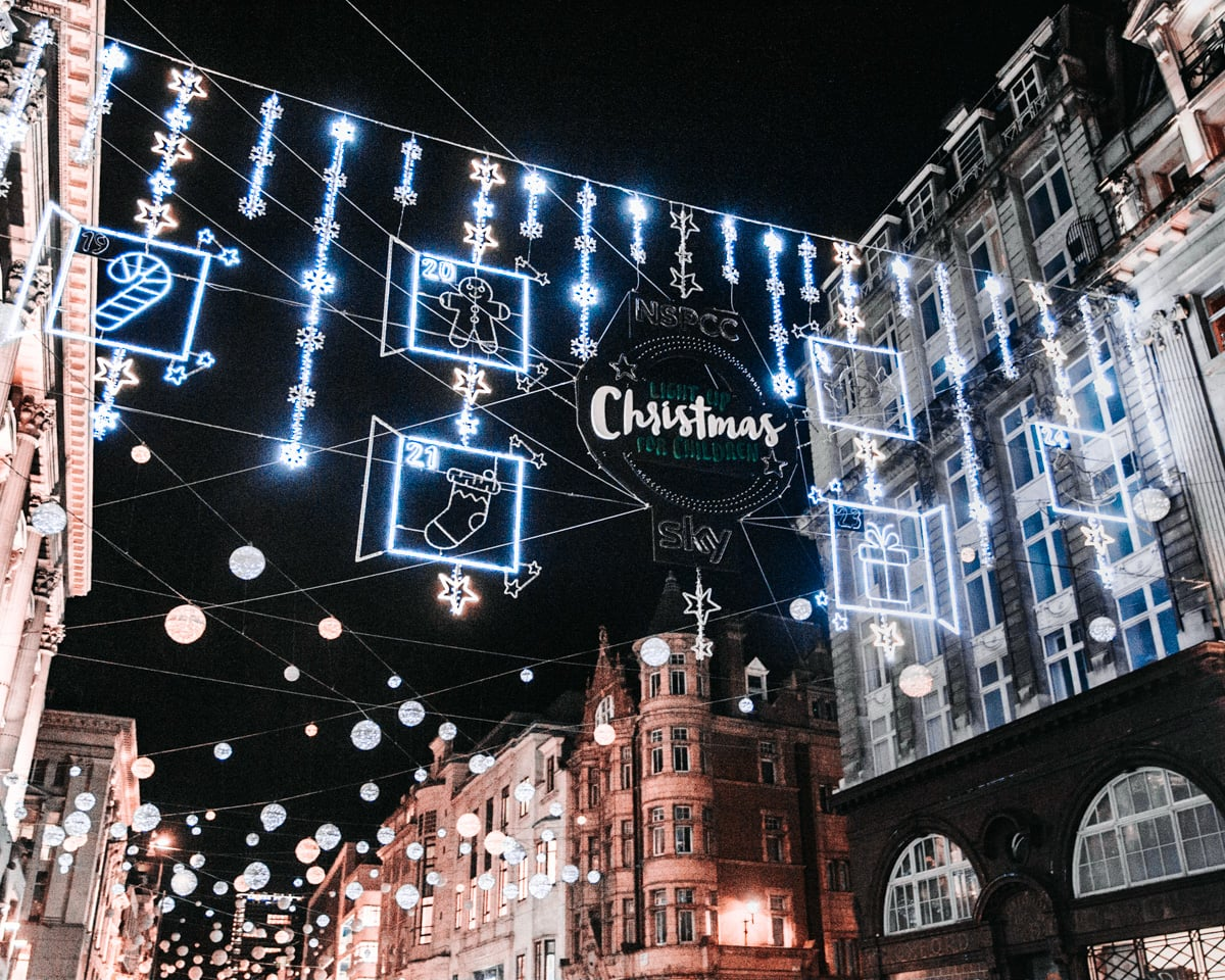 Oxford Street's Christmas lights at the intersection with Regent Street. Find all the best places to see Christmas lights in London here with a free map to plan your Christmas in London.