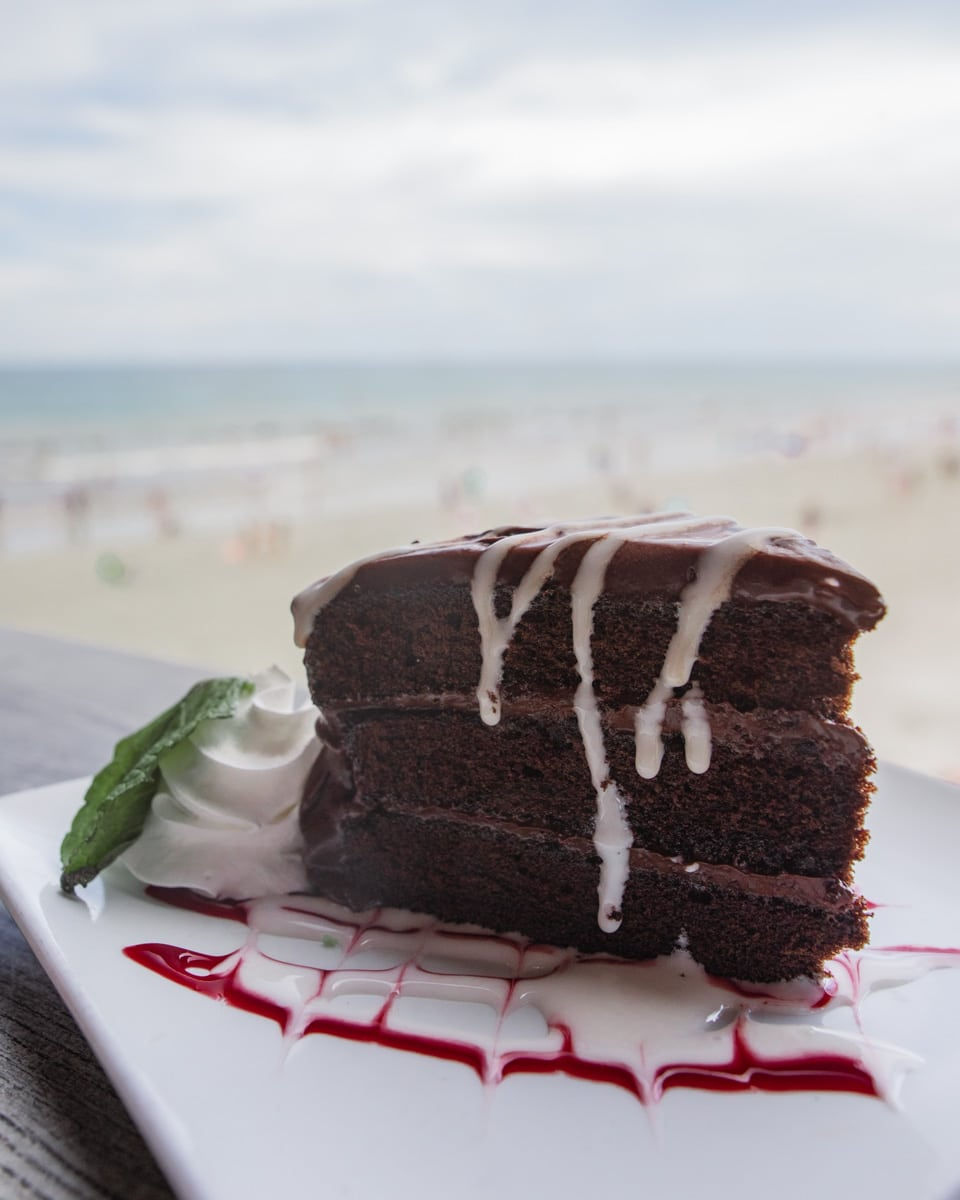 Chocolate cake with a beach view at Pelican's Bar & Grille on Westgate Cocoa Beach Pier