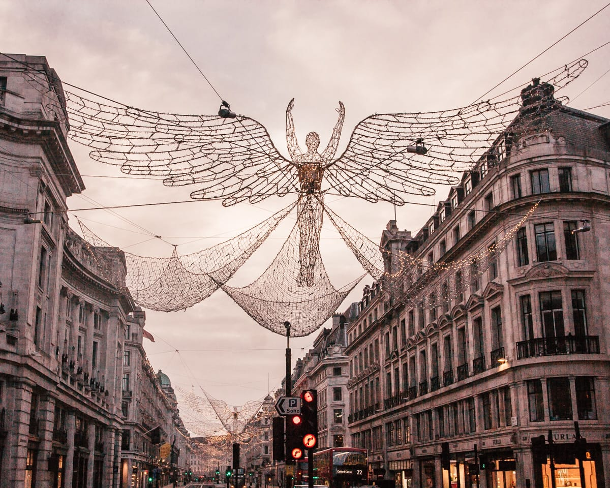 Regent Street Spirit of Christmas angels spanning the street. Click here for the ultimate guide to Christmas lights in London including a free map!