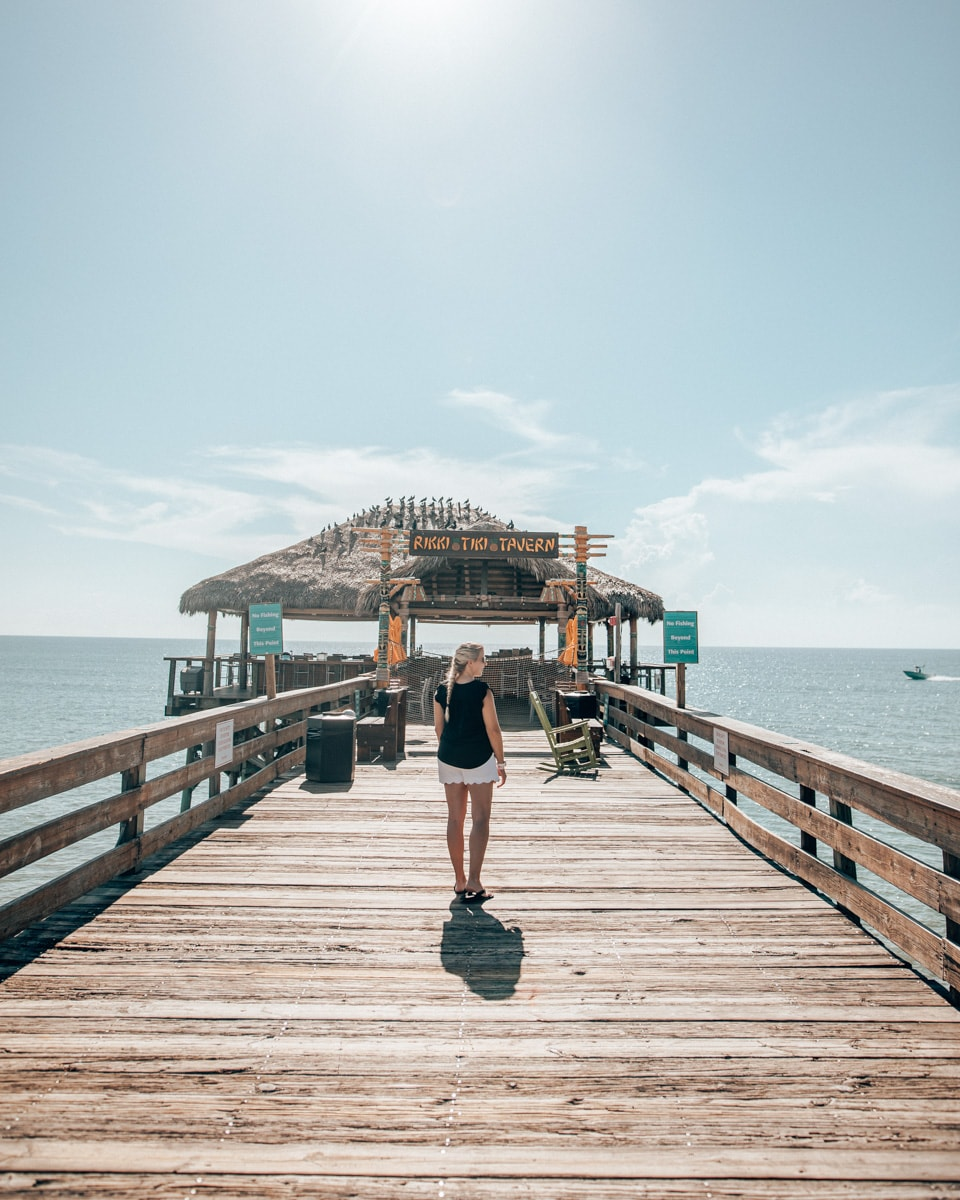 Woman walking towards Rikki Tiki Tavern at the end of the Westgate Cocoa Beach Pier