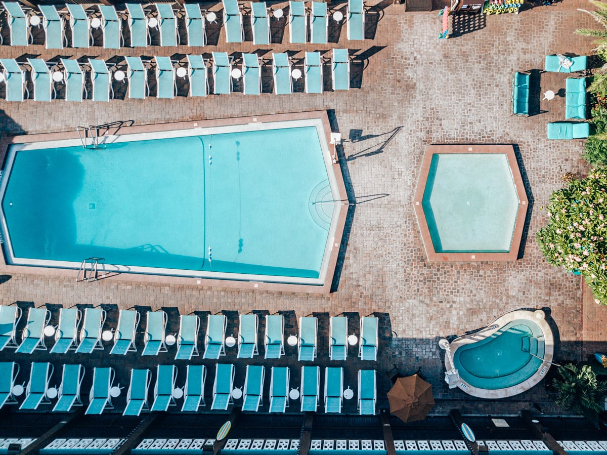The main pool, kiddie pool and hot tub at Westgate Cocoa Beach Resort taken from a drone.